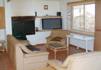 Large open plan lounge, dining area with enclosed built-in braai and TV