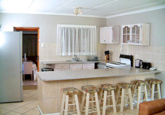 Open plan kitchen is fully equipped