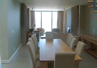 Spacious, open plan sitting/dining area with sea view