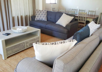 Open plan lounge with comfortable couches and dining area