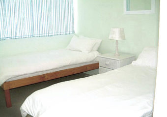 Bedroom downstairs has 2 single beds