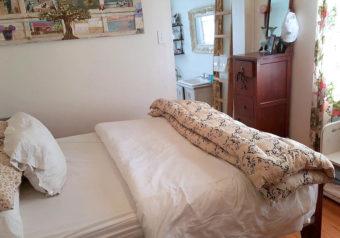 Main bedroom with double bed and en suite bathroom