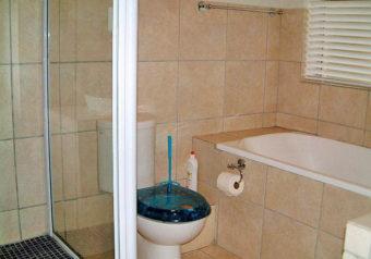Bathroom with bath, shower, basin and toilet