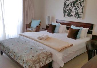 Comfortable bedroom with queen-size bed and en suite bathroom
