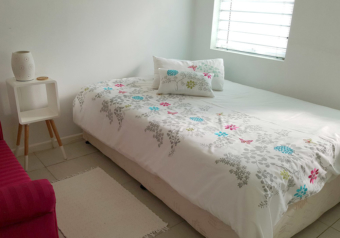 Three bedrooms with a double bed in each