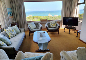 Lounge with view of the ocean and TV with DSTV connection